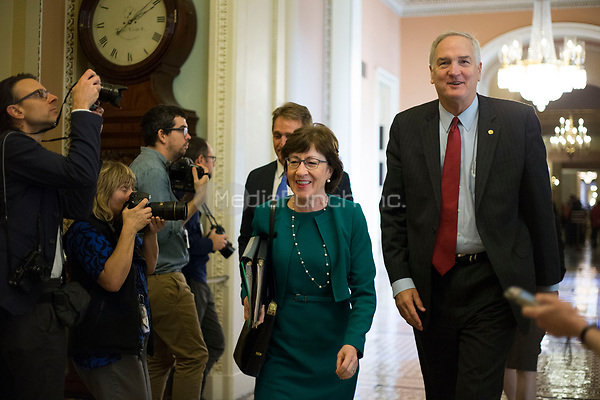 United States Senator Jeff Flake (Republican of Arizona) left, and US Senator Luther Strange (Republican of Alabama) right, led by US Senator Susan Collins (Republican of Maine) walk to the US Senate Chamber for a procedural vote in the US Capitol in Washington, DC on Friday, December 1, 2017. <br /> Credit: Alex Edelman / CNP /MediaPunch