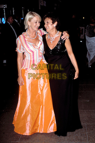 "HELEN MIRREN & JULIE WALTERS.at the ""Calendar Girls"" Premiere, Leicester Square.black dress, orange skirt, striped blouse, stripy, embrace, arms around each other, full length, full-length.www.capitalpictures.com.sales@capitalpictures.com.© Capital Pictures"