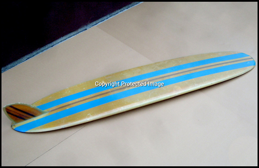 BNPS.co.uk (01202 558833)<br /> Pic: RockawayRecords/BNPS<br /> <br /> ****Please use full byline****<br /> <br /> The bottom.<br /> <br /> A surfboard belonging to legendary Beach Boys drummer Dennis Wilson which featured on the covers of two of their most famous albums has emerged for sale for £100,000.<br /> <br /> The iconic blue and yellow board was used for the cover of the Beach Boys' groundbreaking debut album, 1962's Surfin' Safari, and again in 1963 on the front of Surfer Girl.<br /> <br /> Wilson, the band's only surfer, brought the 9ft board along to the band's first ever professional photo shoot held on a beach in California in 1962 shortly after they signed with Capitol Records.<br /> <br /> The five members - Brian, Dennis and Carl Wilson, their cousin Mike Love and friend Al Jardine - were snapped holding it while striking various poses on a beach. The photos from the session went on to become some of the most iconic images of the band.<br /> <br /> Wilson gave the board to his close friend Louis Marotta in the 1970s who in turn passed it on to Beach Boys fan Bob Stafford in 1985.<br /> <br /> Mr Stafford is now selling the board with a whopping price tag of £100,000 after a short stint on display at the Grammy Museum in Los Angeles to mark the band's 50th anniversary.