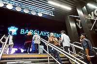 Crowds arrive via subway on opening night for the Barclays Center in Brooklyn in New York on Friday, September 28, 2012. The new venue opened with eight concerts by the rapper Jay-Z, a part owner in the arena, and is expected to be the major economic engine for a change in the neighborhood.   (© Richard B. Levine)