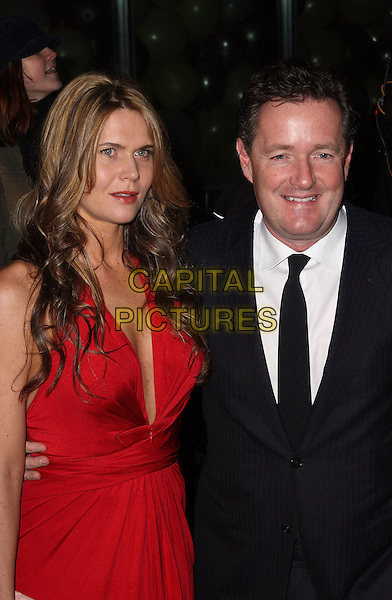 CELIA WALDEN & PIERS MORGAN .Arrivals at The Love Ball, the Roundhouse, Camden, London , England, UK, February 23rd 2010.half length dress black red couple tie low cut plunging neckline white shirt smiling arm around .CAP/JIL.©Jill Mayhew/Capital Pictures.