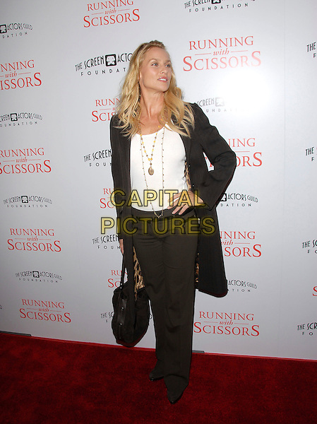 "NICOLLETTE SHERIDAN.attends The TrisStar Pictures' World Premiere of ""Running with Scissors"" held at The Academy of Motion Pictures Arts & Sciences in Beverly Hills, California, USA, October 10th 2006..full length black coat mac leopard print lining inside white top necklace Nicolette.Ref: DVS.www.capitalpictures.com.sales@capitalpictures.com.©Debbie VanStory/Capital Pictures"