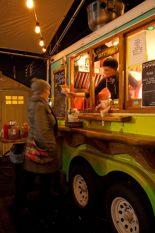 Potato Champion, a food cart in Portland, Oregon's SE Hawthorne district that sells home made french fries. Chef/Owners Kourtney Paranteau takes orders from the window of their food cart.