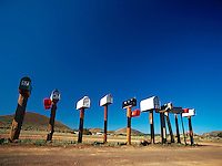 Row of mailboxes in a rural area.