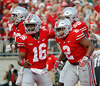 Ohio State Buckeyes quarterback J.T. Barrett (16) and  running back J.K. Dobbins (2) celebrate after a touchdown in the third quarter of Saturday's NCAA Division I football game at Ohio Stadium in Columbus on September 16, 2017. Ohio State won the game 38-7. [Barbara J. Perenic/Dispatch]