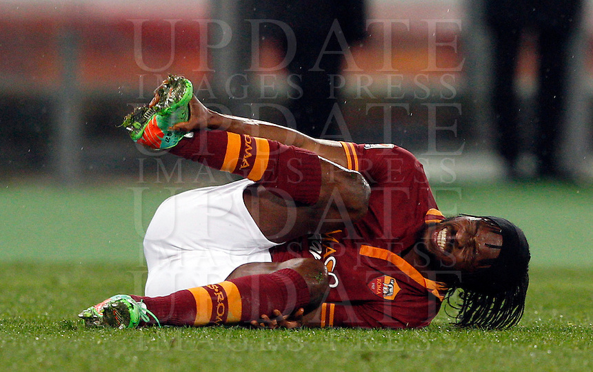 Calcio, Serie A: Roma vs Torino. Roma, stadio Olimpico, 25 marzo 2014.<br /> AS Roma forward Gervinho, of Ivory Coast, reacts after being injured during the Italian Serie A football match between AS Roma and Torino at Rome's Olympic stadium, 25 March 2014.<br /> UPDATE IMAGES PRESS/Riccardo De Luca