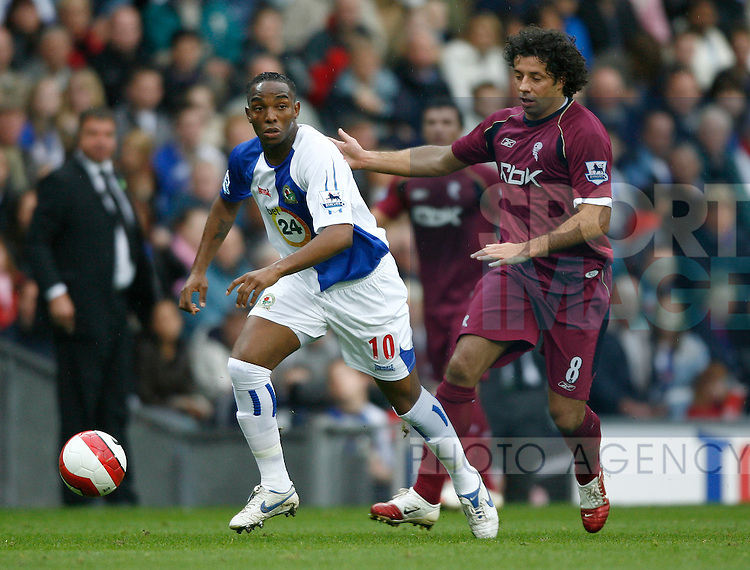 Blackburn Rover's Benni McCarthy and Bolton Wanderer's Ivan Campo