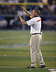 UNLV's Head Coach Bobby Hauck works the sidelines during the second half of an NCAA college football game in Reno, Nev., on Saturday, Oct. 26, 2013. UNLV defeated Nevada 27-22.<br /> Photo by Cathleen Allison