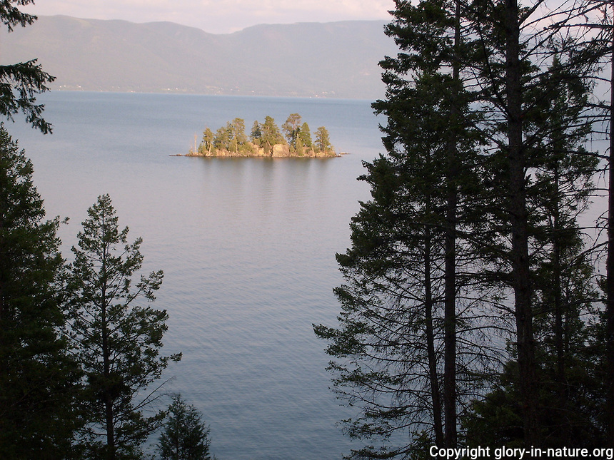 Picturesque evening view of an island in the middle of Flathead Lake, Montana