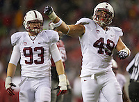 SEATTLE, WA - September 28, 2013: Stanford defensive end Ben Gardner, right, celebrates a sack against Washington State at CenturyLink Field. Stanford won 55-17