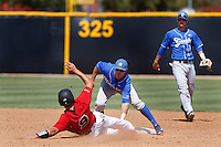 Woody Woodward #5 of the UC Santa Barbara Gauchos tags out Alexis Mercado #9 of the Cal State Northridge Matadors at second base during a game at Matador Field on May 12, 2013 in Northridge, California. Cal State Northridge defeated UC Santa Barbara 7-1. (Larry Goren/Four Seam Images)