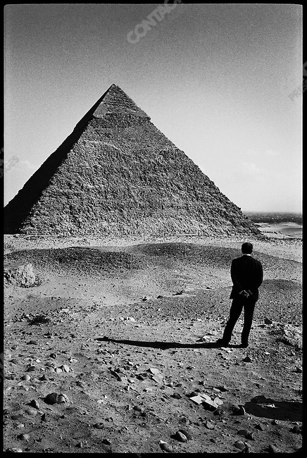 Egyptian President Anwar el-Sadat posing in front of Gizeh Pyramids, two weeks before his meeting with Israeli Prime Minister Menachem  Begin. Pyramids of Gizeh, Egypt, December 1977