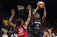 Washington, DC - August 25, 2019: New York Liberty center Tina Charles (31) goes up for a shot over Washington Mystics forward LaToya Sanders (30) during second half action of game between the New York Liberty and the Washington Mystics at the Entertainment and Sports Arena in Washington, DC. The Mystics defeated New York 101-72. (Photo by Phil Peters/Media Images International)