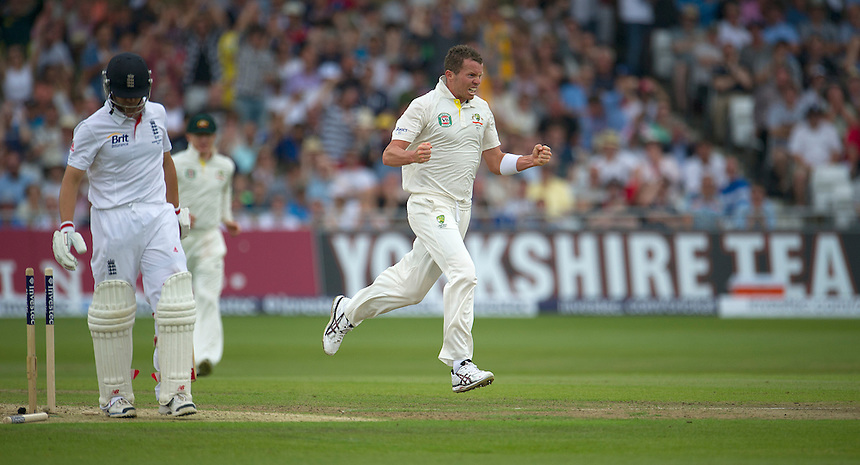 Australia's Peter Siddle celebrates taking the wicket of England's Jonathan Trott as the England batsman starts his walk back to the pavilion - IJL Trott b Siddle 48<br /> <br />  (Photo by Stephen White/CameraSport) <br /> <br /> International Cricket - First Investec Ashes Test Match - England v Australia - Day 1 - Wednesday 10th July 2013 - Trent Bridge - Nottingham<br /> <br /> &copy; CameraSport - 43 Linden Ave. Countesthorpe. Leicester. England. LE8 5PG - Tel: +44 (0) 116 277 4147 - admin@camerasport.com - www.camerasport.com