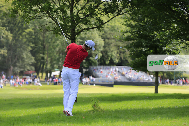 Ross Fisher (ENG) plays his 2nd shot from the rough on the 9th hole during Sunday's Final Round of the 2014 Irish Open held at Fota Island Resort, Cork, Ireland. 22nd June 2014.<br /> Picture: Eoin Clarke www.golffile.ie