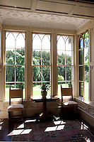 A Gothic bay window in the drawing room has an elaborate Jacobean plasterwork ceiling