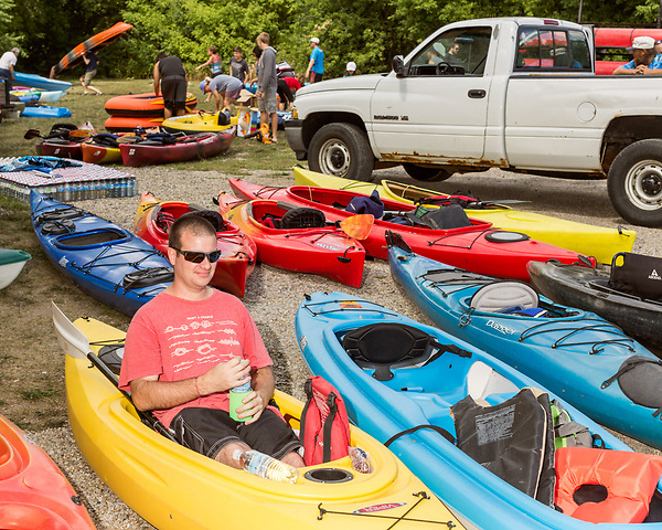 August 6, 2016. Flint, Michigan.<br />  Ryan Maiers waits to kayak down the Flint River. <br />  The 3rd annual Flint River Flotilla was held to raise awareness about the river, it was not the cause of the water crisis, and brought hundreds of people to the river for a several mile float. <br />  In April 2014, the city of Flint switched its water source from the Detroit Water and Sewerage Department to using the Flint River in an effort to save money. When the switch occurred, the city failed to have corrosion control treatment in place for the new water. This brought about a leaching of lead from pipes into the water, increasing the lead content in the drinking water to levels far above legal limits. After independent sources brought this to light, the city admitted the water was unsafe and legal battles have ensued between resident and the local and state governments.