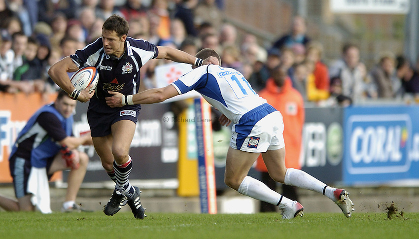 Photo: Jonathan Butler..Bristol Rugby v Bath Rugby. EDF Anglo-Welsh Cup. 01/10/2006..Marko Stanojevic of Bristol is tackled by Ian Davey of Bath.