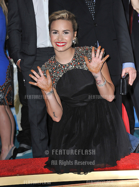 "Demi Lovato at the season two premiere of ""X Factor USA"". She and the other judges had their handprints set in cement at Grauman's Chinese Theatre, Hollywood..September 11, 2012  Los Angeles, CA.Picture: Paul Smith / Featureflash"