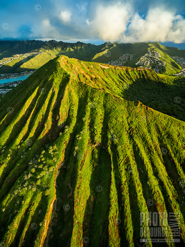 An aerial view of peak and ridges of Koko Crater with the valleys of southeastern O'ahu in the distance, Honolulu, O'ahu.