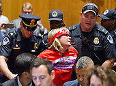 "A protestor is forcibly removed from the room by United States Capitol Police as the US Senate Committee on Finance was to conduct the ""Hearing to Consider the Graham-Cassidy-Heller-Johnson Proposal"" on the repeal and replace of the Affordable Care Act (ACA) also known as ""ObamaCare"" in Washington, DC on Monday, September 25, 2017.<br /> Credit: Ron Sachs / CNP"