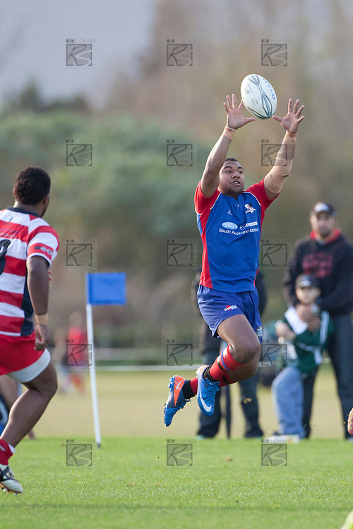Preston Elama has to leap high to take a wayward pass during the Counties Manukau Premier Club Rugby game between Ardmore Marist and Karaka played at Bruce Pulman Park Papakura on Saturday June 11th 2011. Karaka won 42 - 25 after leading 21 - 18 at the break.