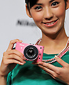 "September 21, 2011, Tokyo, Japan - Model poses with new digital camera ""Nikon 1 J1"" during a press conference in Tokyo, Japan, on September 21, 2011. (Photo by AFLO) [3620]"