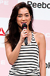 """Fashion model Anne Nakamura speaks during the Reebok Skyscape Fashion Show on April 15, 2015, Tokyo, Japan. Miranda Kerr, who is very popular in Japan, is the Reebok global ambassador for the new footwear line """"Skyscape"""". Models Anne Nakamura, Tina Tamashiro and Funassyi, mascot of Funabashi city in Chiba, also attended the event. (Photo by Rodrigo Reyes Marin/AFLO)"""