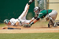 April 23, 2011:    Jacksonville University Dolphins catcher Alex Swenson (14) is upended as he slides safely under the tag of Stetson Hatters catcher Nick Rickles (9) during Atlantic Sun Conference action between Stetson Hatters and Jacksonville University Dolphins at John Sessions Stadium in Jacksonville, Florida.  Jacksonville defeated Stetson 10-4...........