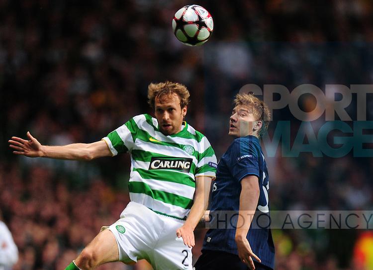 Andreas Hinkel of Celtic and Nicklas Bendtner of Arsenal