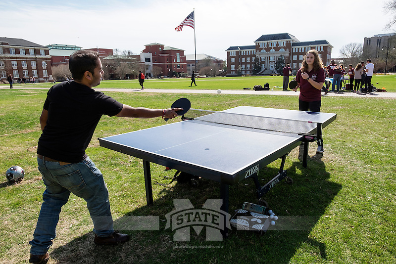 Ping Pong club promotion on the Drill Field: <br /> Soumyadip Kundu (Soum) and Amelia Andersson playing ping pong.<br />  (photo by Megan Bean / &copy; Mississippi State University)