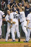 Michael Fuda #15 of the Rice Owls is congratulated at home plate by teammates Jess Buenger #14 and Diego Seastrunk #5 after scoring the winning run in the bottom of the 10th inning versus the UCLA Bruins in the 2009 Houston College Classic at Minute Maid Park February 27, 2009 in Houston, TX.  The Owls defeated the Bruins 5-4 in 10 innings. (Photo by Brian Westerholt / Four Seam Images)