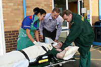 Ambulance personnel during a training session at an NHS hospital.