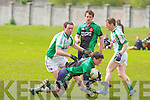 Na Gaeil's Eoin Doody tries to stop Churchill's Chris Hurley in the division 4 game in Tralee on Sunday.