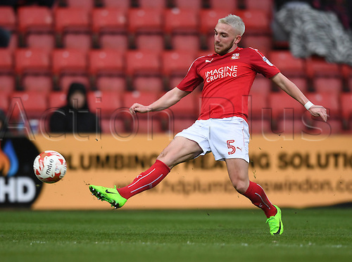 March 4th 2017,  County Ground, Swindon, England; Skybet League 1 football, Swindon Town versus Chesterfield; Anton Rodgers, midfielder for Swindon Town stretches for control