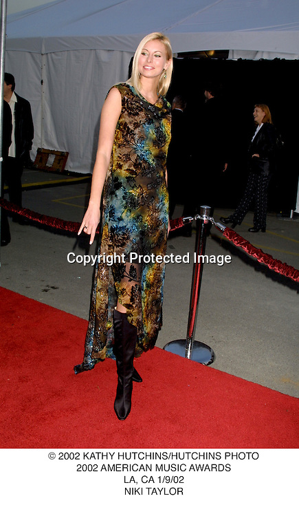 © 2002 KATHY HUTCHINS/HUTCHINS PHOTO.2002 AMERICAN MUSIC AWARDS.LA, CA 1/9/02.NIKI TAYLOR
