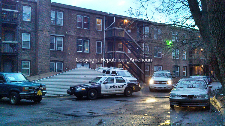 WATERBURY, CT - 18 Jan. 2014 - 011814AL02 - Police were still investigating a fatal shooting at 17 Chestnut Ave. Saturday evening. A 38-year-old Waterbury man was shot behind the building late Friday and died overnight. Andrew Larson / Republican-American