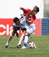 William Quiros (20) of Costa Rica fights for the ball with Ivan Castro (11) of El Salvador during the group stage of the CONCACAF Men's Under 17 Championship at Jarrett Park in Montego Bay, Jamaica. Costa Rica defeated El Salvador, 3-2.