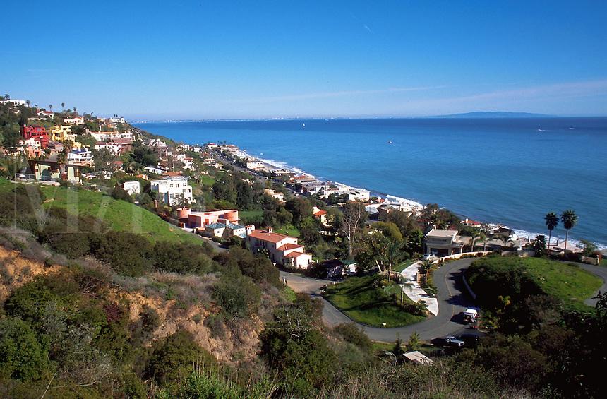 Malibu coastal community homes on a hillside overlooking the Pacific Ocean coastline. California.