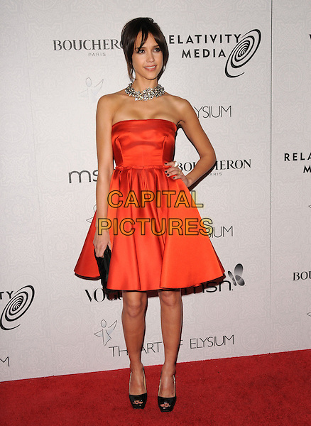"JESSICA ALBA.Art of Elysium 3rd Annual Black Tie charity gala '""Heaven"" held at 990 Wilshire Blvd in Beverly Hills, California, USA, .January 16th 2010 .full length strapless red orange silk satin dress black peep toe shoes platform clutch bag slingbacks hand on hip.CAP/RKE/DVS .©DVS/RockinExposures/Capital Pictures"