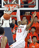 Virginia forward Akil Mitchell (25) dunks the ball during the game against NC State Saturday in Charlottesville, VA. Virginia defeated NC State 58-55.