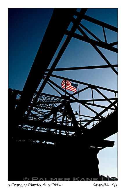 "a steel bridge spanning the Erie Canal with ""old Glory"" flying proudly The Erie Canal, New York State"