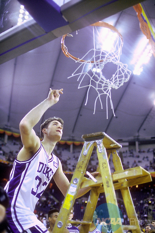 06 APR 1992:  Duke forward Christian Laettner (32) takes his piece of the net after the Blue Devils defeated Michigan 71-51 to win the NCAA Final Four basketball championship held in Minneapolis, MN at the Humphrey Metrodome. Photo Copyright Rich Clarkson