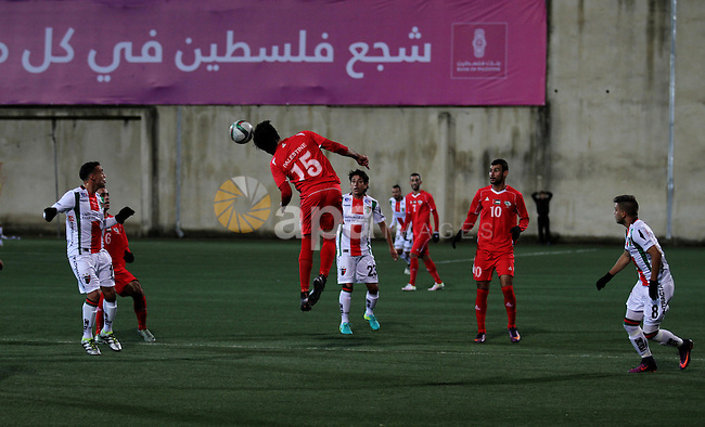 Palestino players and Chile players compete during their friendly soccer match between Palestine and CD Palestino at Nablus Stadium in The West Bank City of Nablus, 13 December 2016. CD Palestino visit West Bank and Gaza for the second time. The club was founded in 1920 by a group of Palestinian immigrants, and plays in the Primera Division of Chile. Photo by Nedal Eshtayah
