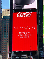 "New York, New York City. Times Square Cola ad, ""Staying apart is the best way to stay united."""