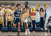 WASHINGTON, DC - FEBRUARY 8: Jeff Dowtin #11 of Rhode Island chses after Shawn Walker Jr. #1 of George Washington during a game between Rhode Island and George Washington at Charles E Smith Center on February 8, 2020 in Washington, DC.