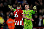 Chris Basham and Dean Henderson of Sheffield United embrace during the Premier League match at Bramall Lane, Sheffield. Picture date: 10th January 2020. Picture credit should read: James Wilson/Sportimage