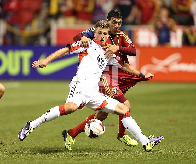 Javier Morales (r) of Real Salt Lake and Conor Doyle (w)  of D.C. United fight for the ball during the second half of the U.S. Open Cup Final on October  1, 2013 at Rio Tinto Stadium in Sandy, Utah. DC United beat Real Salt Lake 1-0 to win the championship.