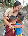 Christian Love Daroy-Gagno, the program director of the Kapatiran-Kaunlaran Foundation (KKFI), hugs children in Pulilan, a village in Bulacan, Philippines, where KKFI has an educational program.<br /> <br /> KKFI is supported by United Methodist Women.