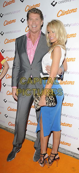 David Hasselhoff & Hayley Roberts  .The Clintons Celebrity Fastcard launch party, No. 5 Cavendish Square nightclub, Cavendish Square, London, England..October 18th, 2011.full length grey gray suit pink shirt striped stripes white sleeveless top fur furry leopard print clutch bag blue skirt puma cat print animal couple side strappy platform sandals .CAP/CAN.©Can Nguyen/Capital Pictures.